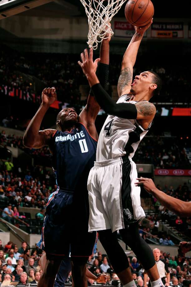 San Antonio Spurs' Danny Green shoots over Charlotte Bobcats' Bismack Biyombo during the first half at the AT&T Center, Wednesday, Jan. 30, 2013. Photo: Jerry Lara, San Antonio Express-News / © 2013 San Antonio Express-News