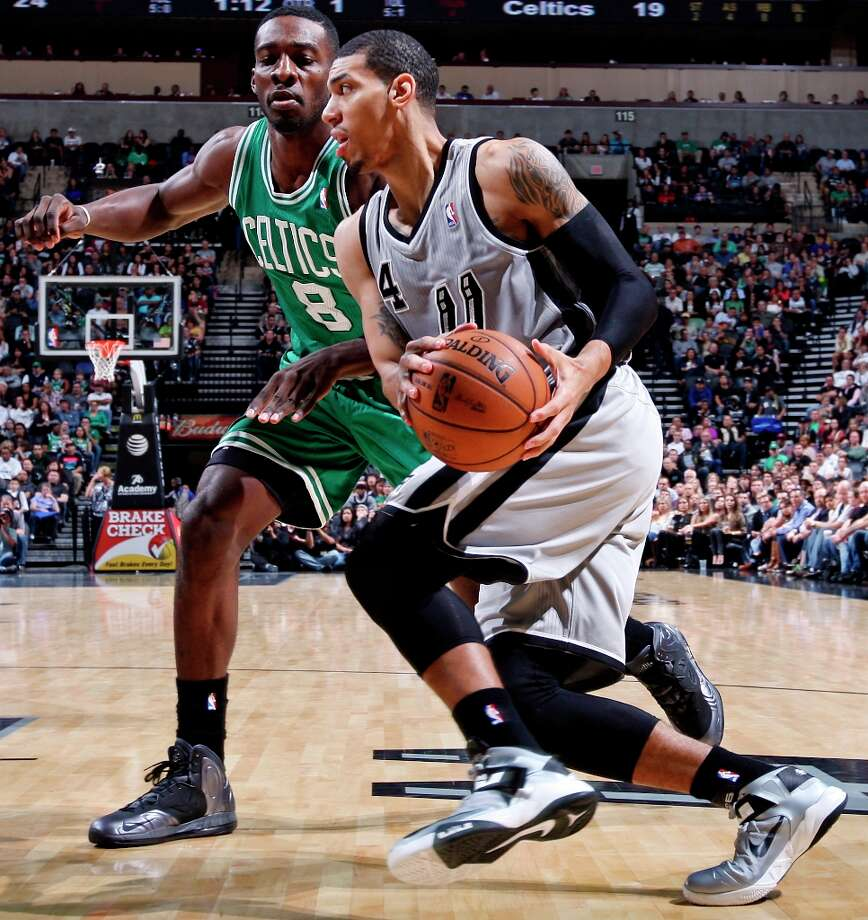 San Antonio Spurs' Danny Green looks for room around Boston Celtics' Jeff Green during first half action Saturday Dec. 15, 2012 at the AT&T Center. Photo: Edward A. Ornelas, San Antonio Express-News / © 2012 San Antonio Express-News