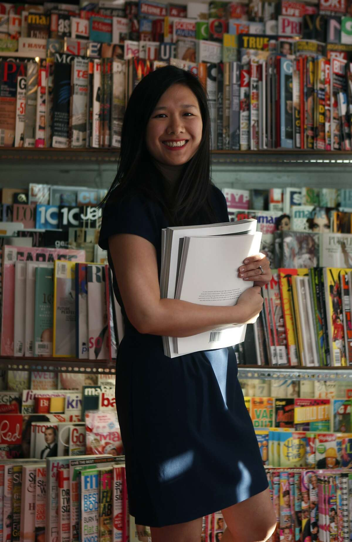 Connie Wong shows Issues news stand in Oakland, Calif., on Thursday, January 9, 2014.