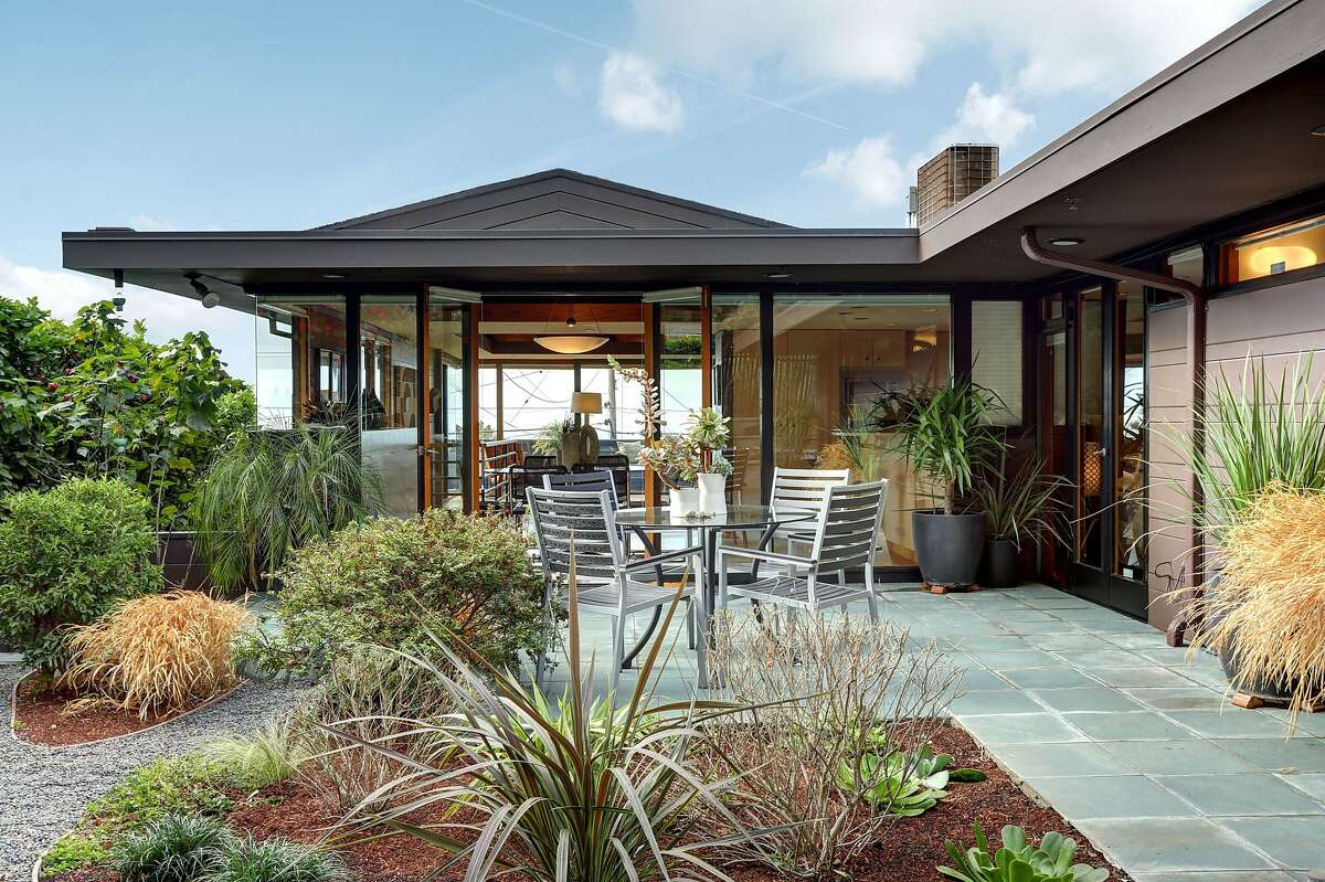 The tile patio and landscaped yard are set off the rear of the home.