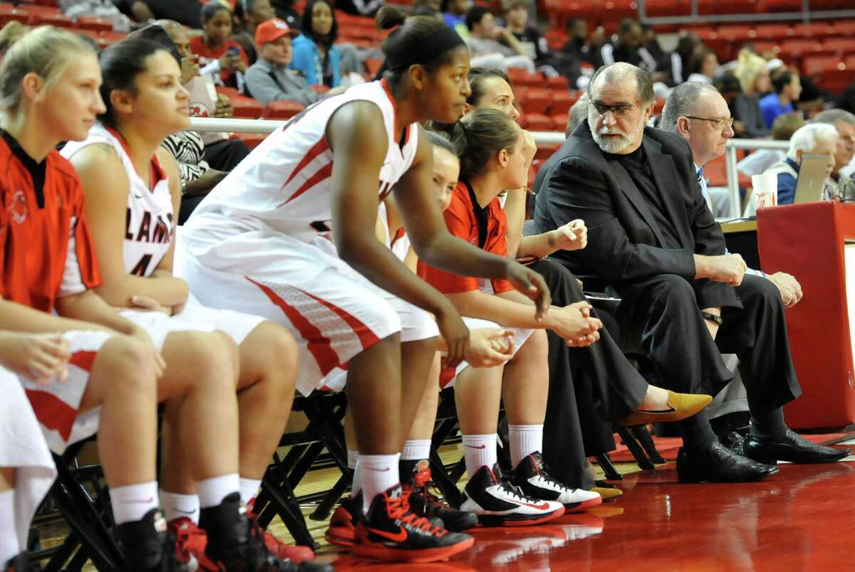 Head Coach Larry Tidwell, right, talks with his Lady Cardinals during the first half of the game. The Lamar University Lady Cardinals tipped off at 5:30 p.m. against the Northwestern State Lady Demons Thursday night. Dave Ryan/The Enterprise