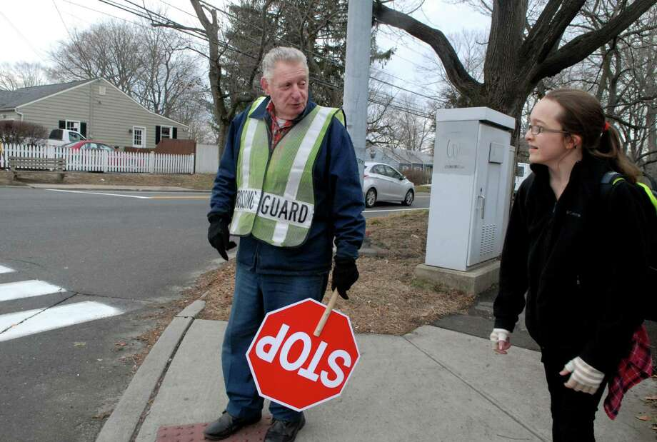 Crossing guard Vito Bova talks with Taylor Vanderpoel (14) while waiting for the light to change on the corner of Hamilton and Courtland Ave in Stamford, Conn. on Monday January 13, 2014. Photo: Dru Nadler / Stamford Advocate Freelance