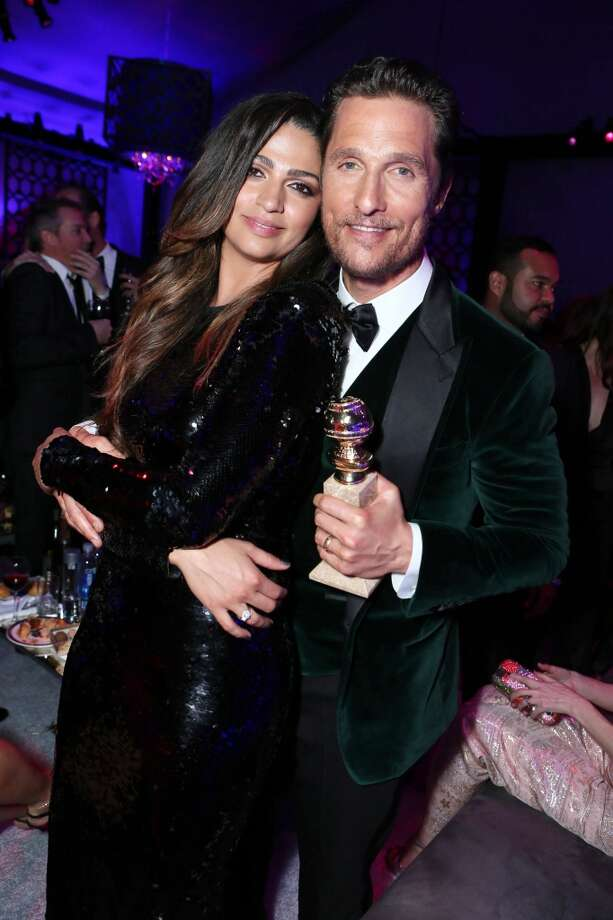 "Camila Alves and Matthew McConaughey with the award for best actor in a motion picture - drama for ""Dallas Buyers Club""  at the 71st Annual Golden Globe Awards – NBC/Universal/Focus Features/E! Entertainment/Chrysler After Party on Sunday, Jan. 12, 2014 in Los Angeles. Photo: Alexandra Wyman, Associated Press"