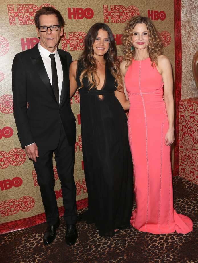 (L-R) Actors Kevin Bacon, Sosie Bacon and Kyra Sedgwick attend HBO's Post 2014 Golden Globe Awards Party held at Circa 55 Restaurant on January 12, 2014 in Los Angeles, California. Photo: Frederick M. Brown, Getty Images