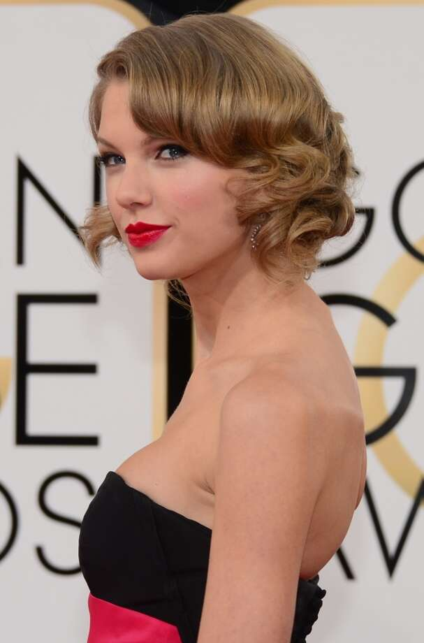 "Bobs. Taylor Swift (whose song for One Chance, ""Sweeter Than Fiction,"" was nominated) in Carolina Herrera. Photo: FREDERIC J. BROWN, AFP/Getty Images"