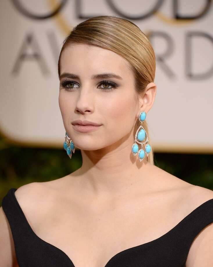 Statement earrings. Emma Roberts (of American Horror Story: Coven) in a Lanvin dress and Neil Lane earring. Photo: Jason Merritt, Getty Images