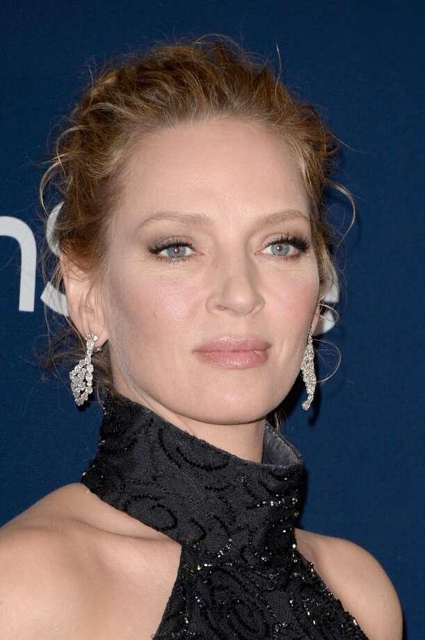 Statement earrings. Uma Thurman in Versace. Photo: Jason Merritt, Getty Images