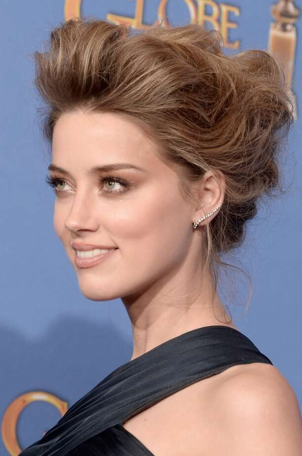 Statement earrings.  Amber Heard in Atelier Versace. Photo: Kevin Winter, Getty Images