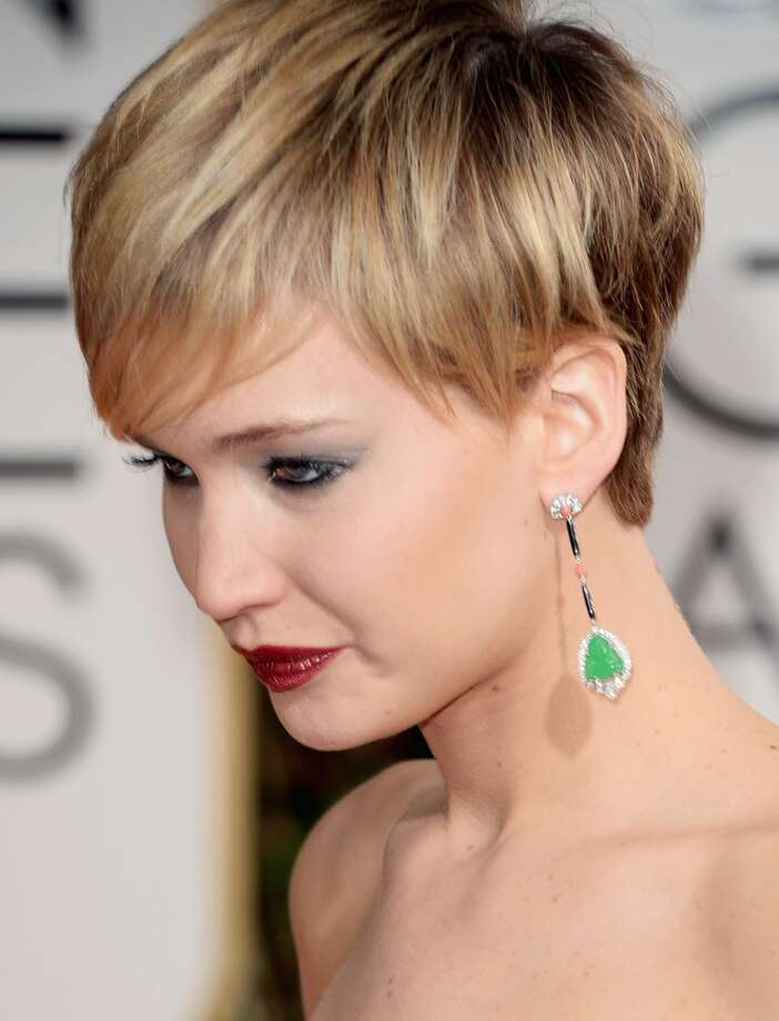 Statement earrings. Jennifer Lawrence (who won for her role in American Hustle) in Christian Dior. Photo: Jason Merritt, Getty Images
