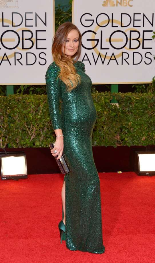 Maternity. Olivia Wilde in emerald sequined Gucci. Photo: John Shearer, Associated Press