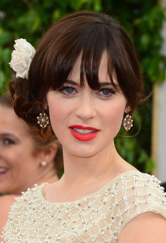The bun. Zooey Deschanel (nominated for New Girl) in Oscar de la Renta. Photo: FREDERIC J. BROWN, AFP/Getty Images