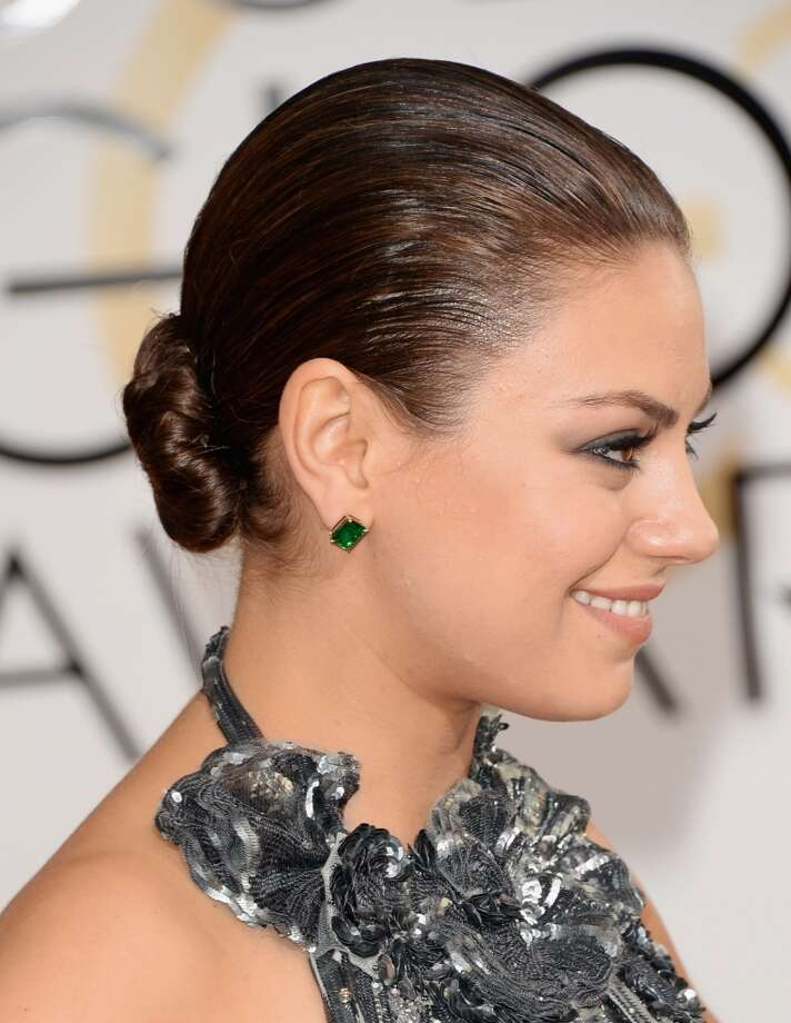 The bun. Mila Kunis in Gucci. Photo: Jason Merritt, Getty Images