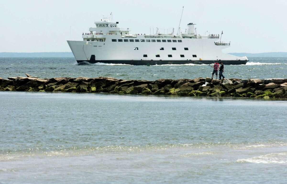 The Port Jefferson ferry passes the breakwater off of Seaside Park in Bridgeport Harbor.