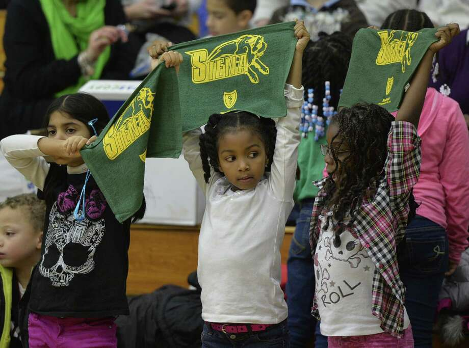 Evelyn Thomas, left, Anairis Ford, center, and Yasmine Fiddemon show the colors of their favorite team during a special Kids Day event where the Siena women's basketball team took on Monmouth  Monday afternoon, Jan. 13, 2014, at Siena Collge in Loudonville, N.Y.  (Skip Dickstein / Times Union) Photo: Skip Dickstein / 00025345A