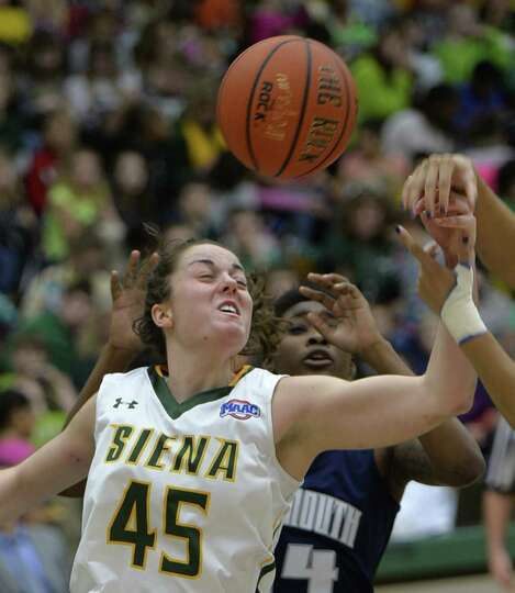 Siena's Meghan Donohue, left, tries for a rebound during a special Kids Day  event against Monmouth