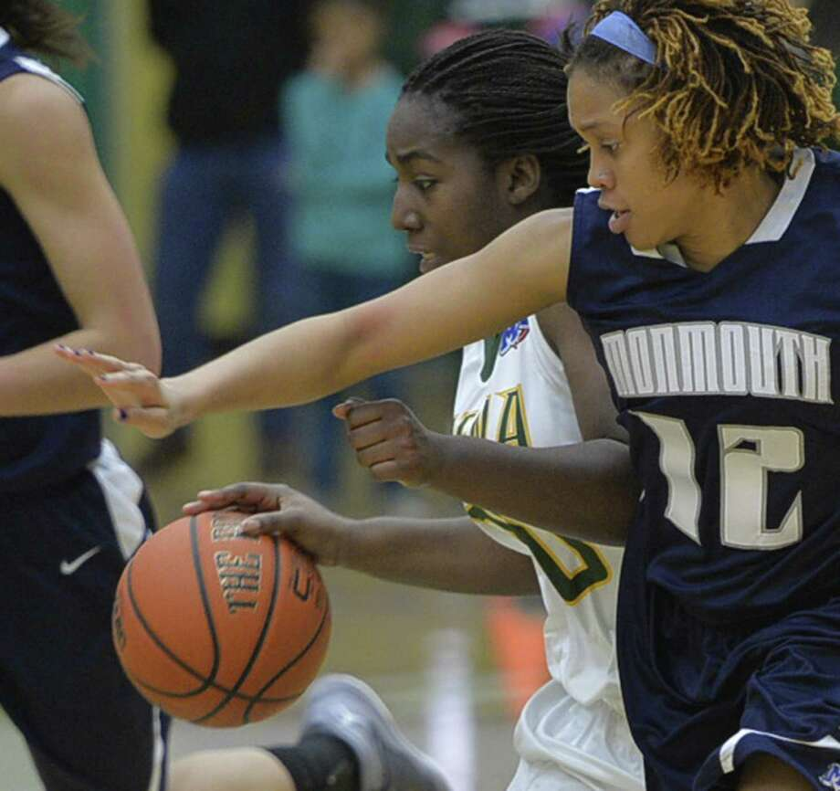 Siena's Kanika Cummings, left, protects the ball against Jamiyah Bethune, right, of Monmouth during a special Kids Day  event Monday afternoon, Jan. 13, 2014, at Siena Collge in Loudonville, N.Y. (Skip Dickstein / Times Union) Photo: Skip Dickstein / 00025345A