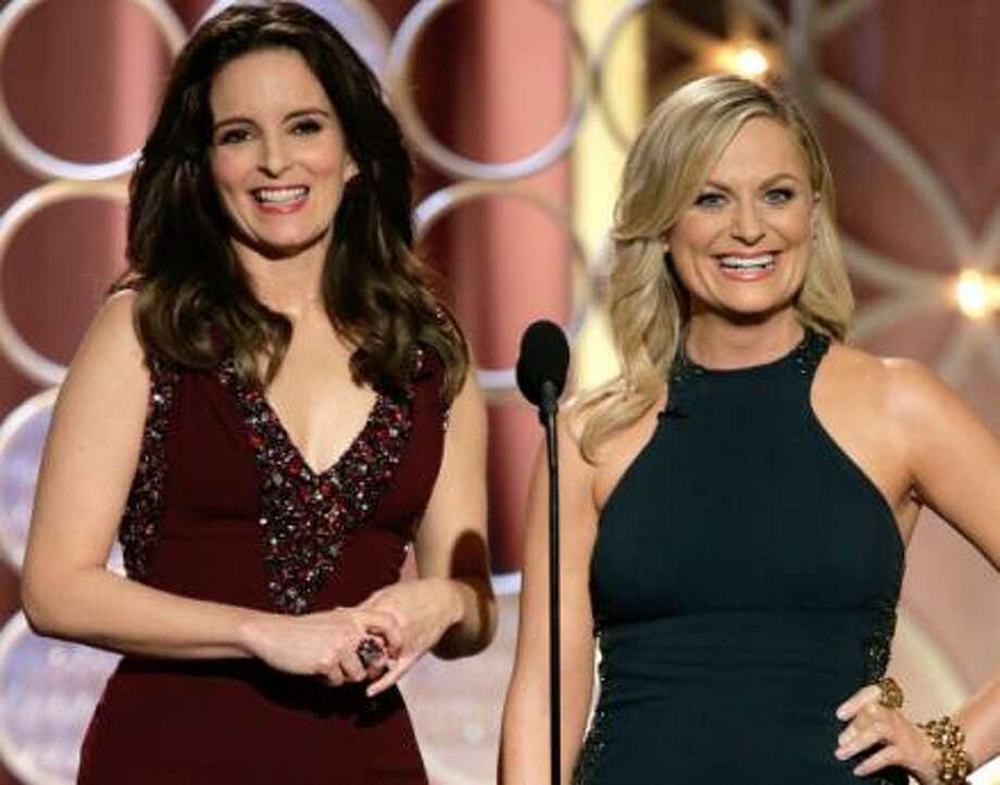 Tina Fey and Amy Poehler in their hosting attire.