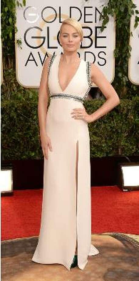 Margot Robbie in white gown.