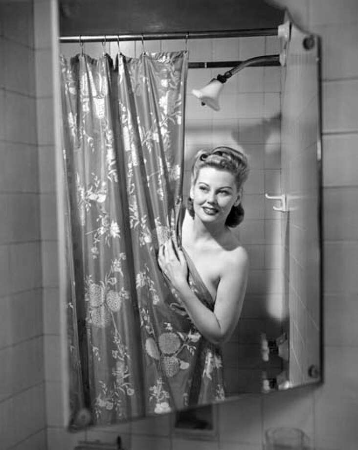 From cavemen to modern day, women have something in common: getting dolled up. It's a practice that has deep-seeded roots in psychology. Take a look at these vintage beauties, like this 1950s lady getting out of the shower, primping for the day ahead. Photo: George Marks, Retrofile/Getty Images / Retrofile