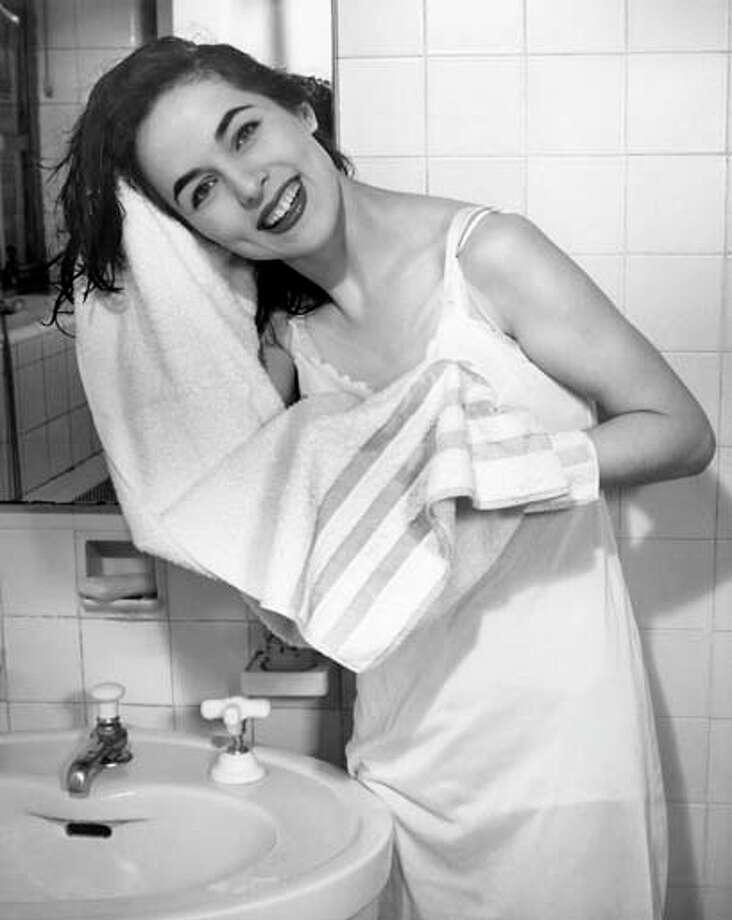 Woman toweling her hair at bathroom sink, circa 1950s. Photo: George Marks, Retrofile/Getty Images / Retrofile