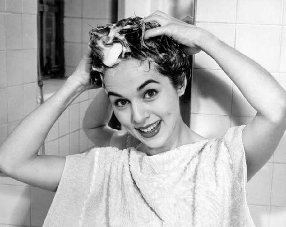 Woman shampooing her hair, circa 1950s. Photo: George Marks, Retrofile/Getty Images / Retrofile