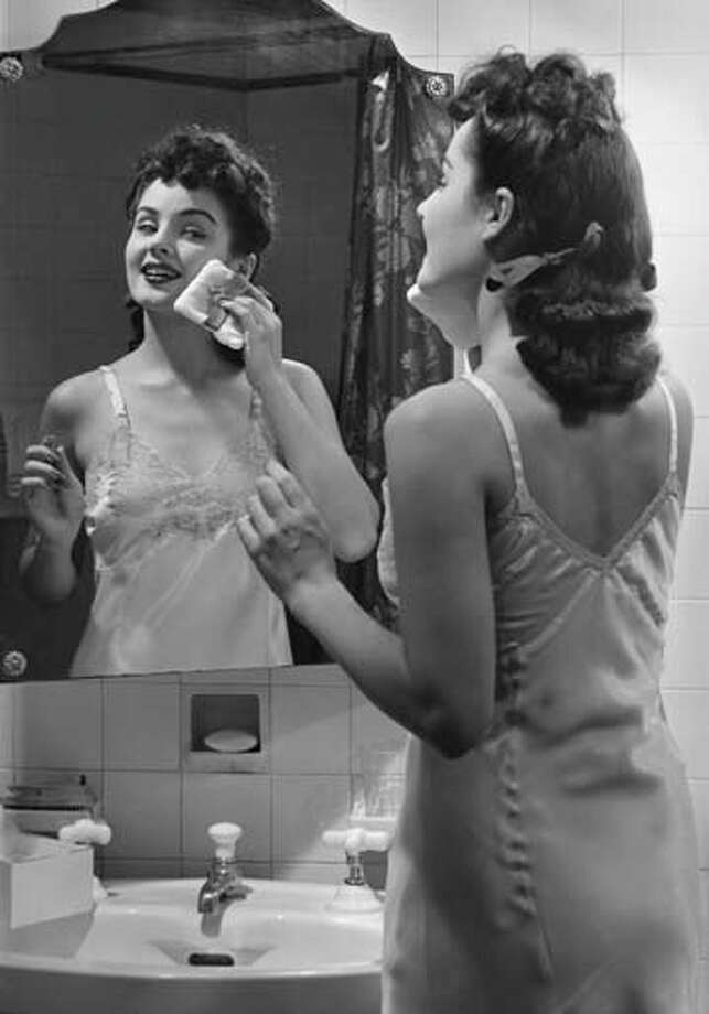 Woman in bathroom, circa 1950s. Photo: George Marks, Getty Images / Hulton Archive