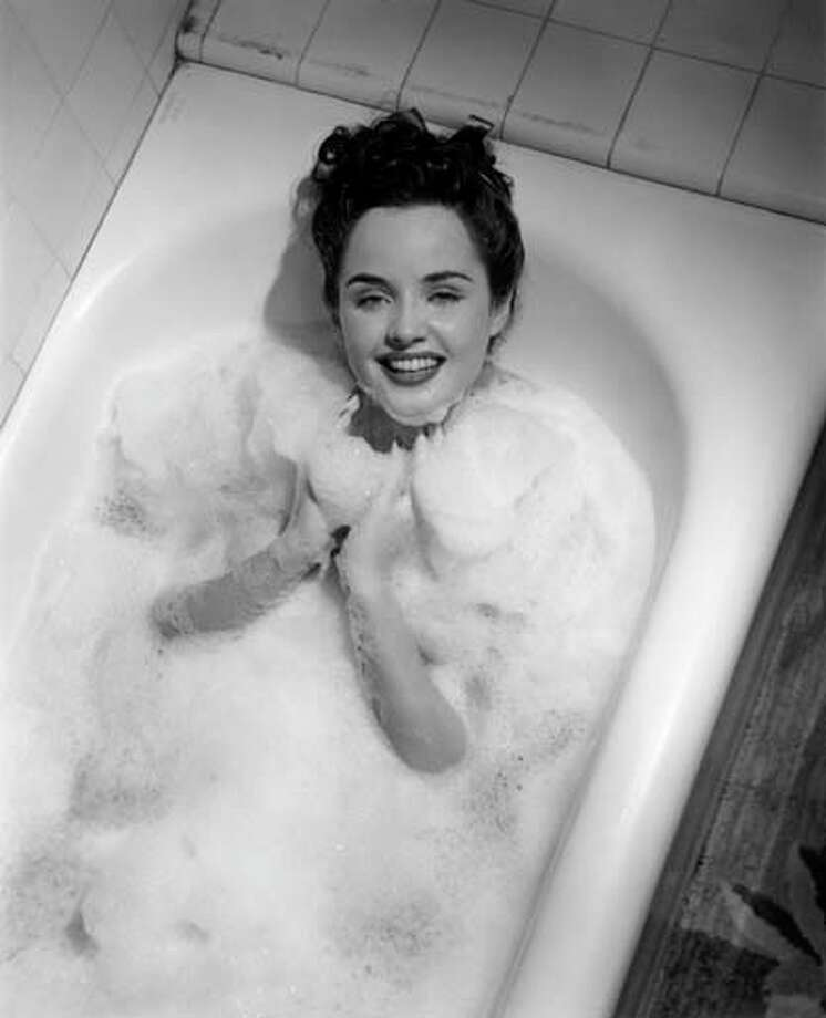 Woman in bathtub with bubbles, circa 1950s. Photo: George Marks, Retrofile/Getty Images / Retrofile