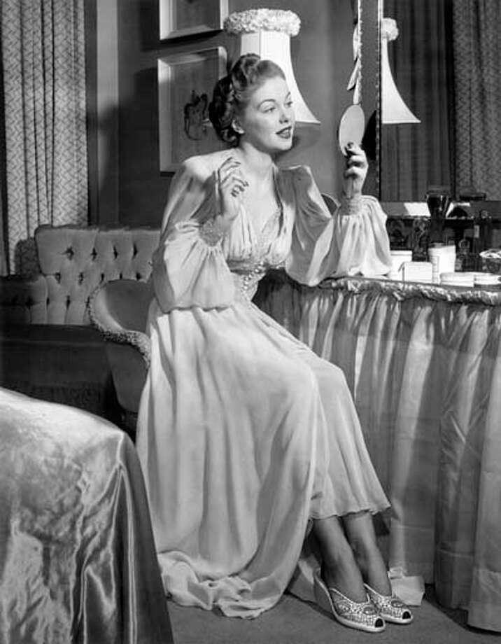 A woman in her nightgown looking in the mirror, circa 1950s. Photo: George Marks, Retrofile/Getty Images / Retrofile
