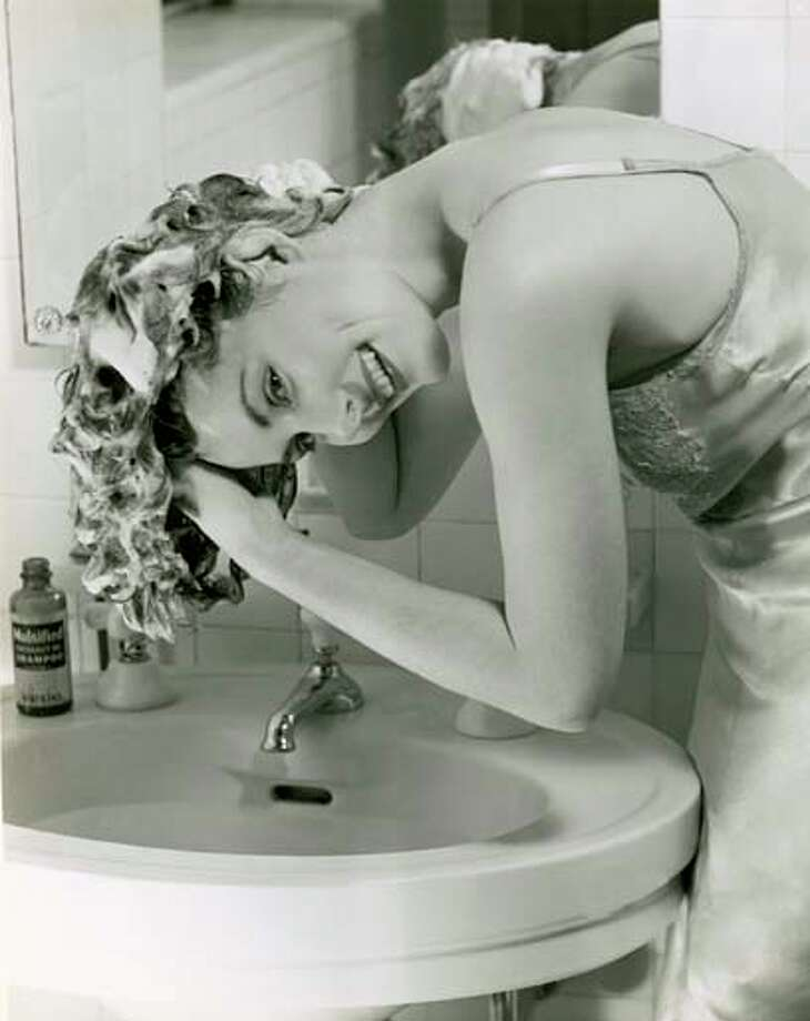 Woman washing her hair in sink, circa 1950s. Photo: George Marks, Retrofile/Getty Images / Retrofile