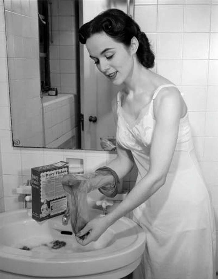 Woman washing her hose at bathroom sink, circa 1950s. Photo: George Marks, Retrofile/Getty Images / Retrofile