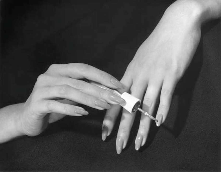 Close-up of hands putting on nail polish, circa 1950s. Photo: George Marks, Retrofile/Getty Images / Retrofile