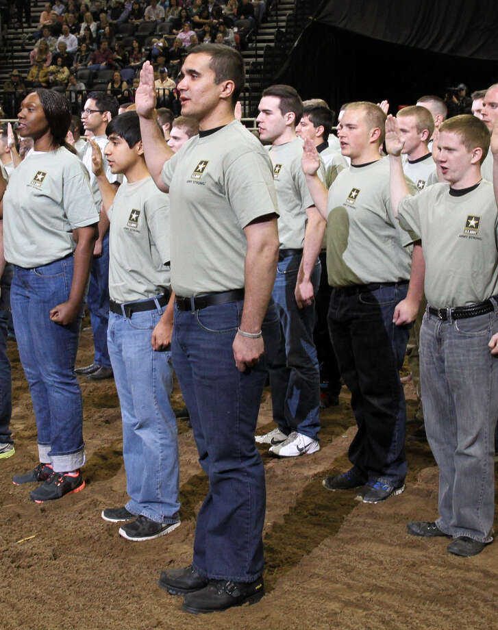 Future soldiers repeat the oath of enlistment in San Antonio as they are sworn  into the armed services. Military facilities have a huge impact on the Texas economy and must be shielded from BRAC. Photo: U.S. Army / U.S. Army North PAO
