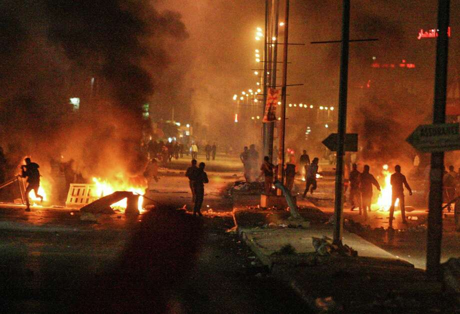 Clashes erupted in Ettadhamen, near Tunis, Tunisia, late Friday evening between police and demonstrators as discontent mounts over new taxes levied by the government. Photo: Aimen Zine / Associated Press / AP