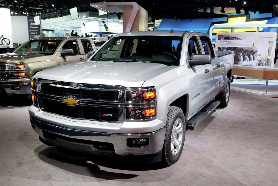 The Chevrolet Silverado has been named North American Truck of the Year at the North American International Auto Show, while the Chevrolet Corvette Stingray has been named North American Car of the Year at the North American International Auto Show in Detroit, Monday, Jan. 13, 2014. Photo: Paul Sancya, Associated Press / Associated Press contributed