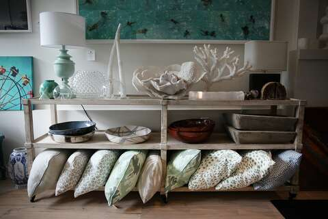 Pillows Ceramic Bowls Trays Lamps And Other Items For Are Displayed On