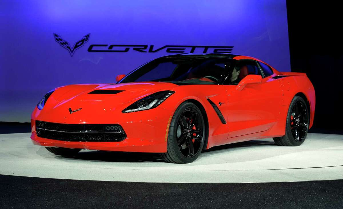 In this Monday, Jan. 14, 2013, file photo, the 2014 Chevrolet Corvette Stingray is revealed at media previews for the North American International Auto Show in Detroit. The Chevrolet Corvette Stingray has been named North American Car of the Year at the North American International Auto Show. The truck of the year is the Chevrolet Silverado. (AP Photo/Paul Sancya, File)