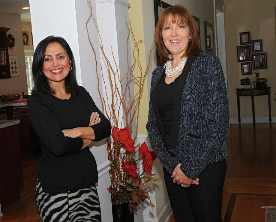 Tangible Development LLC business partners Sujata Chaudhry, left, and Vera Dordick at Sujata's home on Thursday, Jan. 9, 2014 in Schenectady, N.Y. (Lori Van Buren / Times Union) Photo: Lori Van Buren / 00025298A