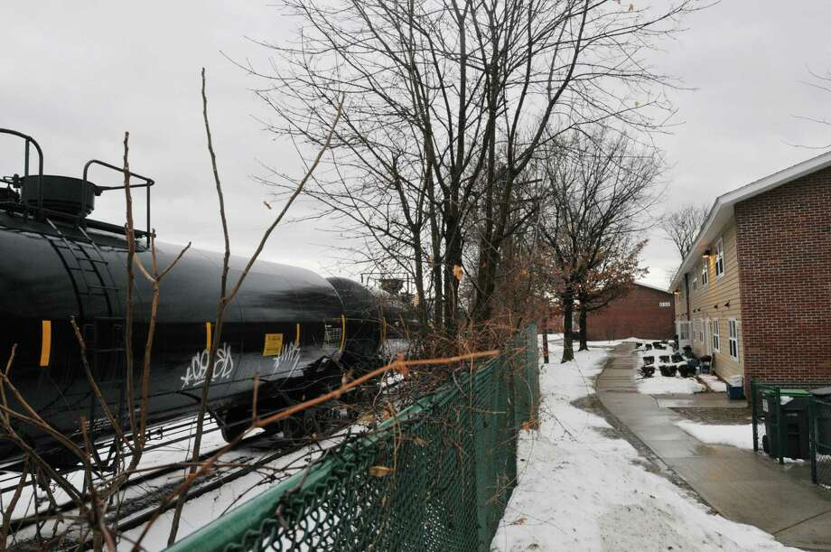 A view of tanker train cars on tracks behind the Ezra Prentice Homes on South Pearl St. on Monday, Jan. 6, 2014 in Albany, NY.   (Paul Buckowski / Times Union) Photo: Paul Buckowski / 00025256A
