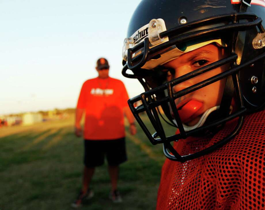 """Friday Nights Tykes"" examines the Texas Youth Football Association in San Antonio. Photo: NBC UNIVERSAL, NBC UNIVERSAL, INC / © 2013 Esquire Network"
