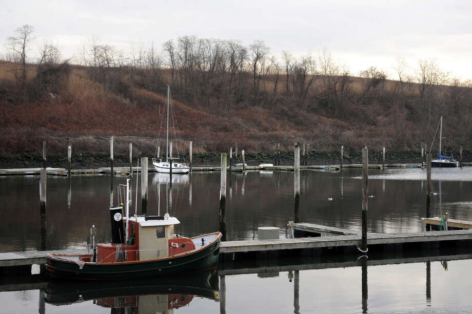 The view looking across Cedar Creek of the old landfill in Bridgeport, Conn., Jan. 13, 2014. The city hopes to install solar panels on the mound to generate electricity. Photo: Ned Gerard / Connecticut Post