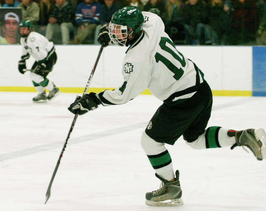 Jack Laucius initiates a Green Wave rush with a pass from the defensive zone during New Milford High School ice hockey's 7-1 victory over Bethel/Brookfield/Danbury at Canterbury School, Jan. 4, 2014. Photo: Norm Cummings / The News-Times