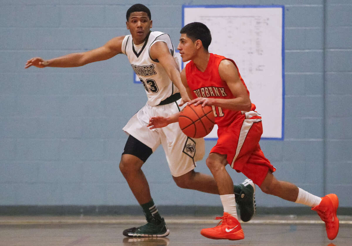 Southwest's Aaron Embry, left, defends Burbank's Gabriel Rangel during their game in the South San Antonio ISD boys basketball tournament at Dwight Middle School on Dec. 5. Burbank claimed a 65-63 win in the game.