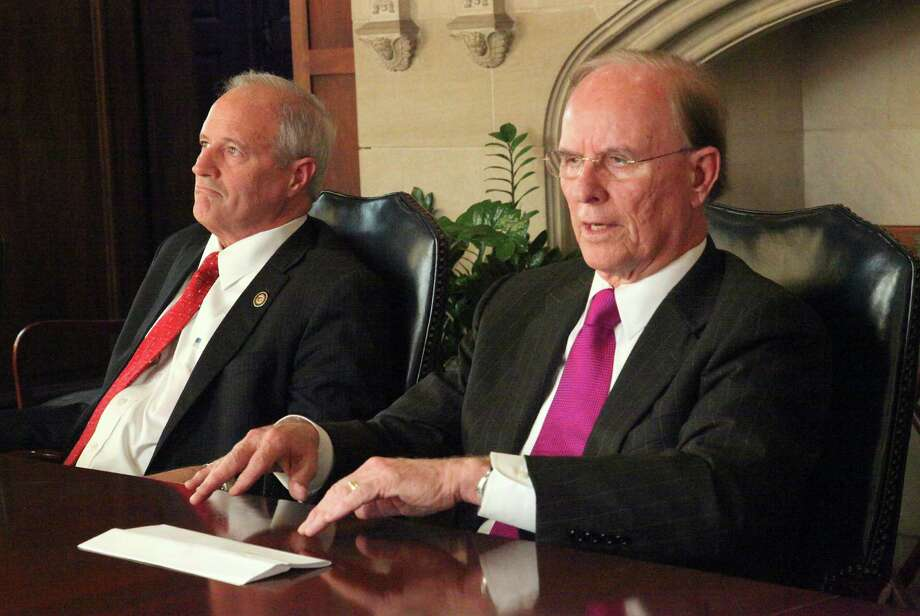County Judge Nelson Wolff (right) and Commissioner Tommy Adkisson are in the Democratic primary for the county judge's post. Photo: Juanito Garza, San Antonio Express-News / San Antonio Express-News
