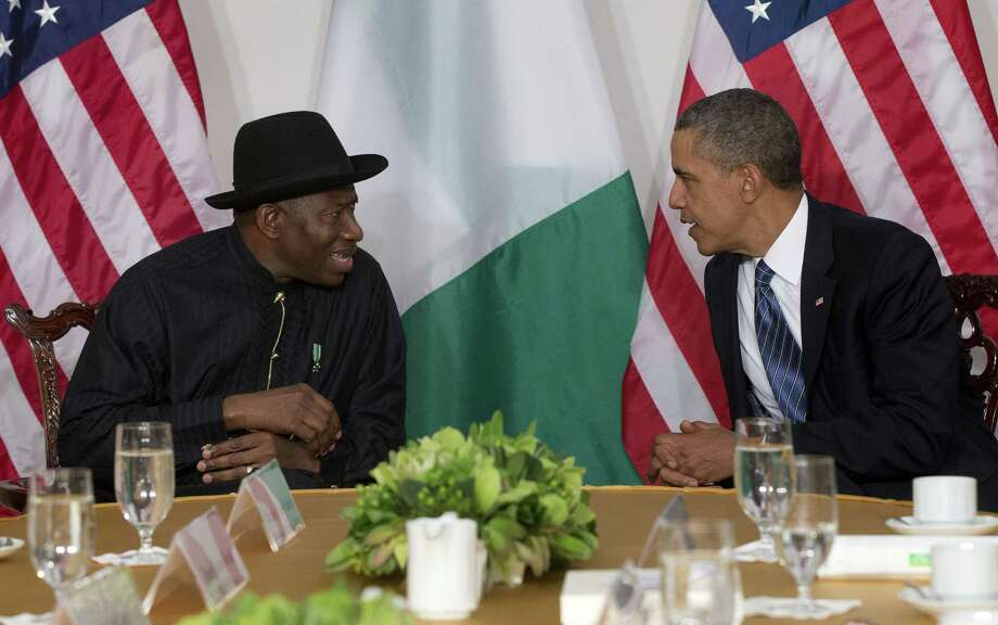 "FILE - President Barack Obama meets with Nigerian President Goodluck Jonathan in New York, in this Monday, Sept. 23, 2013 file photo.  The Associated Press on Monday Jan. 13 2014  obtained a copy of the previously unannounced Same Sex Marriage Prohibition Act  that was signed by President  Jonathan and dated Jan. 7 that bans same-sex marriage and criminalizes homosexual associations, societies and meetings, with penalties of up to 14 years in jail. Secretary of State John Kerry said Monday the United States was ""deeply concerned"" by a law that ""dangerously restricts freedom of assembly, association, and expression for all Nigerians."" (AP Photo/Pablo Martinez Monsivais, File) Photo: Pablo Martinez Monsivais, STF / AP"