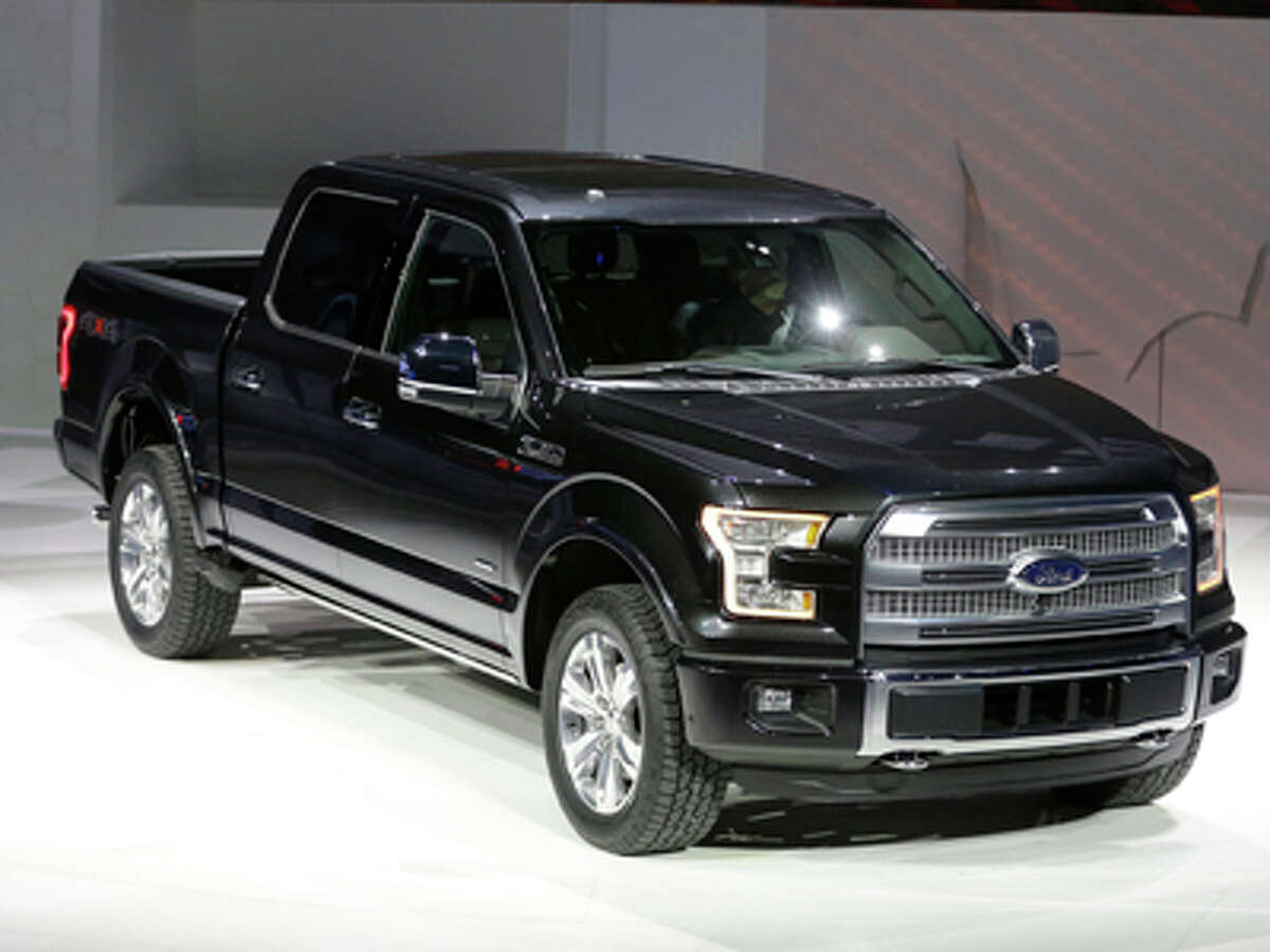 Ford unveils the new F-150 with a body built almost entirely out of aluminum. at the North American International Auto Show in Detroit, Monday, Jan. 13, 2014.