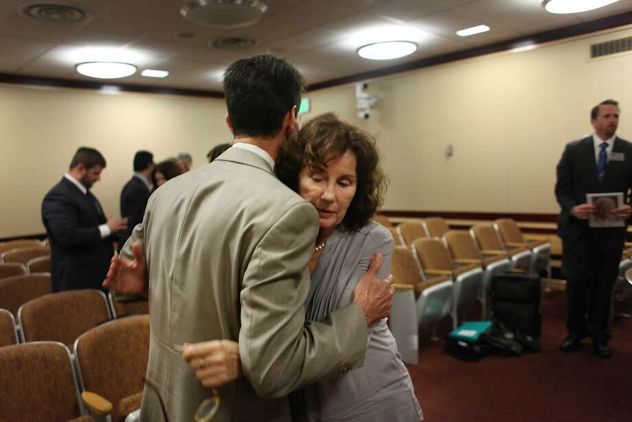 State Sen. Mark Leno (left) hugs Pat McGinnis, executive director of California Advocates for Nursing Home Reform. Photo: Lea Suzuki, The Chronicle