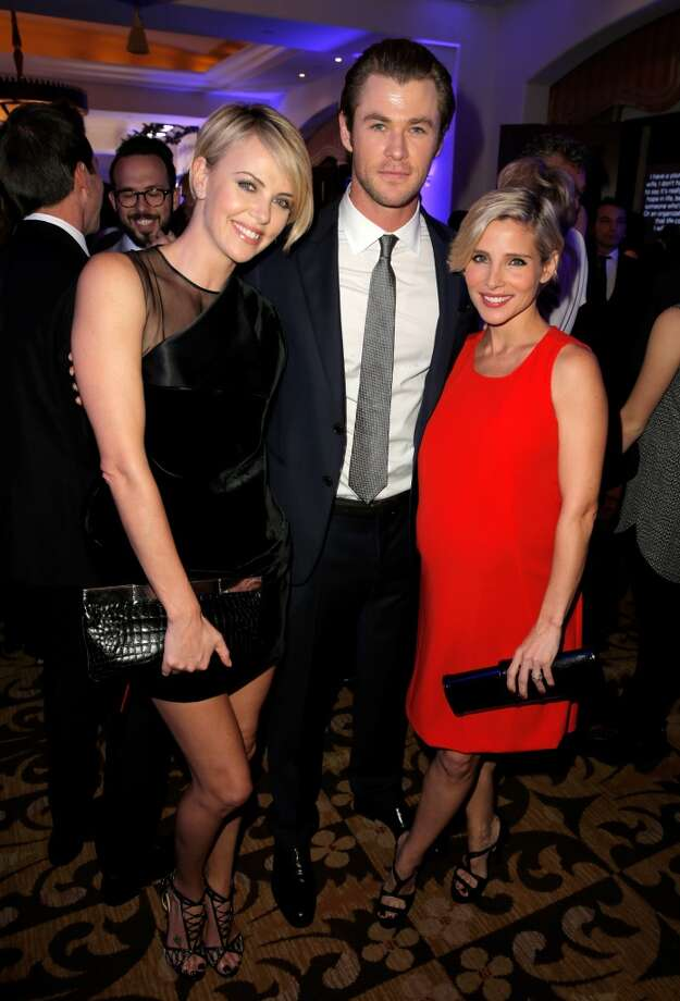 (L-R) Actors Charlize Theron and Chris Hemsworth and Elsa Pataky attend the 3rd annual Sean Penn & Friends HELP HAITI HOME Gala benefiting J/P HRO presented by Giorgio Armani at Montage Beverly Hills on January 11, 2014 in Beverly Hills, California. Photo: Joe Scarnici, Getty Images For J/P Haitian Relief Organization