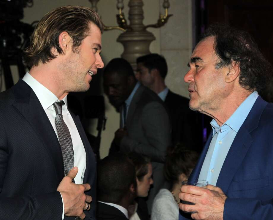 Chris Hemsworth (L) and Oliver Stone attend the 3rd annual Sean Penn & Friends HELP HAITI HOME Gala benefiting J/P HRO presented by Giorgio Armani at Montage Beverly Hills on January 11, 2014 in Beverly Hills, California. Photo: Jonathan Leibson, Getty Images For J/P Haitian Relief Organization