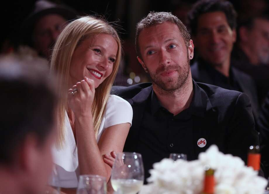 Gwyneth Paltrow, left, and Chris Martin are seen at the 3rd Annual Sean Penn & Friends HELP HAITI HOME Gala on Saturday, Jan. 11, 2014 at the Montage Hotel in Beverly Hills, Calif. Photo: Colin Young-Wolff, Associated Press