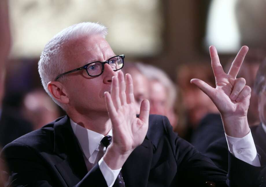 Anderson Cooper is seen bidding during the auction at the 3rd Annual Sean Penn & Friends HELP HAITI HOME Gala on Saturday, Jan. 11, 2014 at the Montage Hotel in Beverly Hills, Calif. Photo: Colin Young-Wolff, Associated Press